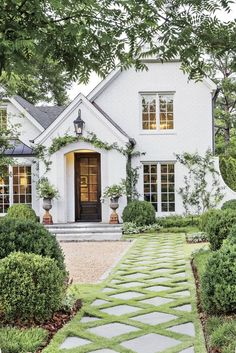 Home Gardening Landscaping Design Dial up the curb appeal by placing key focal points up front like vibrant flower beds and a diamond-patterned bluestone walkway 6 ways to have the best yard on the block gardendesign landscaping outdoordecor Style At Home, Tutor Style Homes, Dream House Exterior, House Exterior Design, Cottage House Exteriors, Stone Home Exteriors, Big Houses Exterior, Simple House Exterior, Colonial House Exteriors