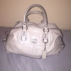 """NWOT Coach Ashley satchel Absolutely gorgeous and exquisite """"Ashley"""" satchel. Brand new, never carried. Soft light grey leather with silver hardware accents and a lilac silky interior. Comes with detachable crossbody strap. Carriage accent on front. Looking to sell and open to all offers but will trade if the right bag comes around . Trade value: 350 Coach Bags Crossbody Bags"""
