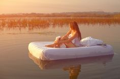Concept: Floating bed! Could totally do this by dressing up a blow-up mattress with nice linens!
