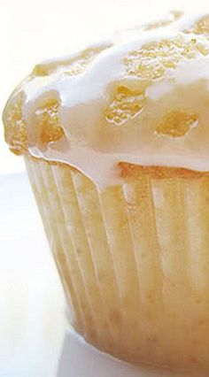 Grapefruit Cupcakes ~ a nice change from your regular lemon cupcake.  The cupcake is fluffy and moist with a delicate flavor of grapefruit, topped with a simple grapefruit-sugar syrup then drizzled with a sweet icing.