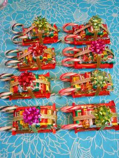 "ellyn's place: candy sleighs    ellynsplace.blogspot.com There are several variations of these on ""you tube""if you put ""candy cane sleigh"" in search box.   A couple that I viewed credited Ellyn's place.  Visit her blog as a thank you and have fun designing your own or borrowing others.  Great hostess gift, a ""little something"" gift, teacher gift, table decoration.  So cute!!!"