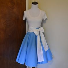 """""""Little town… It's a quiet village…"""" This beautiful sky blue skirt and white sash combination is perfect for a day as Belle! Skirt will be 23 inches long, have a hidden zipper, and be made out of high-quality, 100% cotton fabric. Hem will be finished with a serger and not rolled under, see pictures for details. Photographed with and without a petticoat for your reference. Please see last image for help with sizing. Check the shop announcement for current processing time. Before emailing in…"""