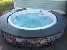 A custom stone sitting wall adds elegance to this #btv backyard retreat