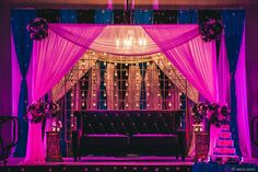 A tent with rented lounge furniture is an exotic choice for a sweetheart table.