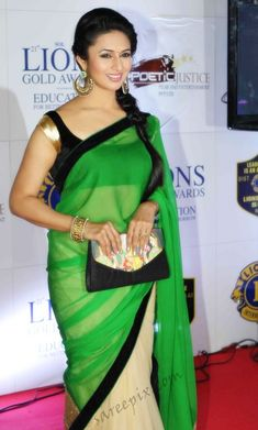 Hindi serial actress Divyanka tripathi photos in half and half saree at 21 Lions gold awards 2015.