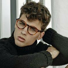 Model Daniel Illescas in round retro tortoiseshell glasses and black turtleneck sweater