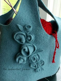 Re-purposing wool sweater Bag tutorial 2019 Gorgeous bag made from recycled sweaters (felted wool). I love the roses trim! The post Re-purposing wool sweater Bag tutorial 2019 appeared first on Wool Diy. Recycled Sweaters, Wool Sweaters, Knitting Sweaters, Alter Pullover, Felt Purse, Felt Bags, Fru Fru, Simple Bags, Easy Bag