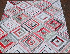 Hyacinth Quilt Designs: Ruby Strings quilt  I love the way everything matches up, but each block is still so different.  I also love black, white, and red quilts.