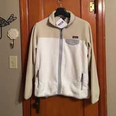 """Patagonia Full-Zip Snap-T Jacket This is a women's full zip snap-t fleece jacket. Size XL. This is such a warm, cozy fleece. Literally the only reason I'm selling it is because I found out my best friend has the exact thing and I don't want us to match everywhere we go! It is called """"Birch White,"""" and has gray and tan accents. Patagonia Jackets & Coats"""