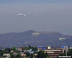 Poetry in motion!     Endeavour Goes to Hollywood Credit: Tom Bleicher   SPACE.com reader Tom Bleicher sent in this photo of shuttle Endeavour flying over Los Angeles with the iconic Hollywood sign in the background, September 21, 2012.