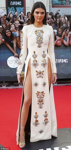 Kendall Jenner made sure all eyes were on her at the 2014 MuchMusic Video Awards in a white embellished Fausto Puglisi gown with very high slits and Tom Ford heels http://dailym.ai/1kY0wu2