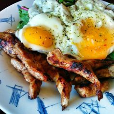 """""""Grilled pork and eggs on a bed of green chard, spinach and kale #foodie #foodporn #paleo #paleodiet"""""""