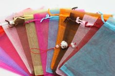 100 Organza Mixed Colors Jewelry Pouch Bags Display 4 X 5 Inches Click Down http://www.amazon.com/dp/B0043KH4NE/ref=cm_sw_r_pi_dp_uW-Eub1BY1WTQ