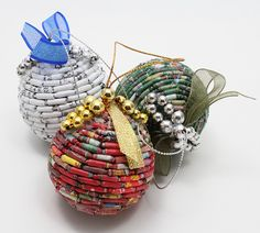 paper bead Christmas ornaments by three stone steps, via Flickr.  Great use for old xmas paper