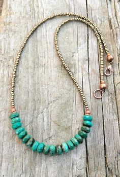Brilliant blue green genuine, faceted turquoise rondelles with matte bronze seed beads and copper accents. Approx 17.5 in length.