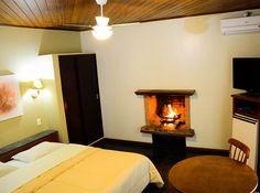Acomodação superior com a charmosa lareira.  http://www.vilaverdehotel.com.br/superior.asp