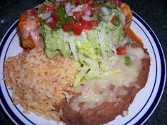 Authentic Mexican Stye Shredded Beef and Bean Chimichanga with Mexican Rice and Refried Bean