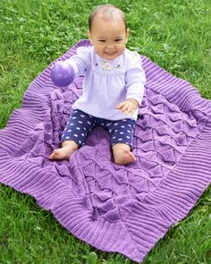 Delicate lace triangles make this baby blanket a stunning addition to any nursery. Shown in Bernat Cotton-ish by Vickie Howell.