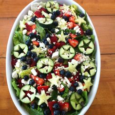 My 4th of July Salad (2012): fresh romaine lettuce, blueberries, strawberries cut in small chunks, cucumber stars (cut outs done with cookie cutter) and Feta cheese. Served with poppyseed dressing.