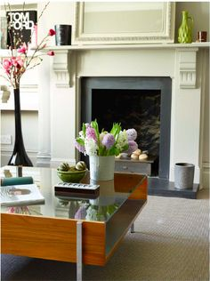 Victorian flat, Fulham. Designed and styled by Imperfect Interiors. www.imperfectinteriors.co.uk Photographs by Rachael Smith Living Room featuring painted fireplace, antique wooden mirror, Fired Earth paint, Robin Day coffee table
