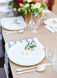 Backyard Bistro by Lauren Kelp: IKEA striped kitchen towel napkins, manilla tag place cards with a sprig of rosemary