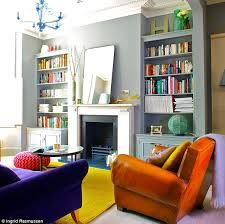Colourful Victorian terrace living room with build in storage.