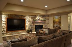 Basement ideas - stone not necessary, i just like that the hearth goes all the…