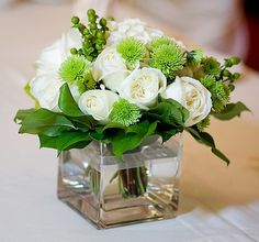 white Roses, green Button Flowers and green Hypericum Berries, dark greenery. so easy to do