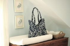 Jenny Steffens Hobick: Vera Bradley tote (washable & with multiple internal compartments) as a diaper bag, plus booties in frames as nursery artwork Light Blue Nursery, Sheep Mobile, Nursery Artwork, Nursery Inspiration, Nursery Ideas, Room Ideas, Blanket Chest, Cozy Room, Pottery Barn Kids