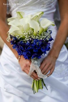 White Calla Lilies and Blue Delphiniums create this Bridal Bouquet by Florals by Rhonda llc. Sarah Lee Welch Photography llc http://www.floralsbyrhonda.com/gallery_W6SD.html