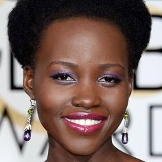 Who: Lupita Nyong'o What: Shades of Purple How-To: The reason Nyong'o pulls off the matchy-matchy thing so brilliantly every time: She plays with texture and shade. Last night on the Golden Globes red carpet, the actress coordinated shimmery lavender eye shadow and glossy berry lipstick with violet accessories and a Giambattista Valli dress for a monochromatic color scheme that didn't feel monotonous. To make powder eye shadow as vibrant as possible, Nyong'o's makeup artist Nick Barose ...