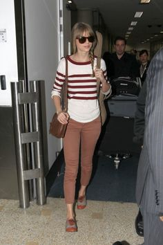 Taylor wore a pair of Mother The Looker Skinny jeans in Rust heading through LAX.