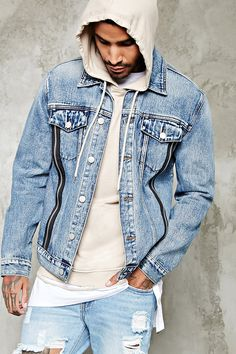3070439ca64 A denim jacket featuring zipper accents down the front, buttoned flap chest  pockets, a