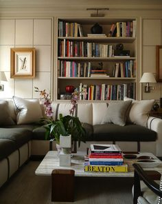 Library by NY Designer David Kleinberg-tradition with modern touches, features linen-paneled walls with nailhead trim in a grid pattern. Large sectional marries form and function, also doubles a queen size pull-out bed. My Living Room, Living Area, Living Spaces, Beautiful Interiors, Beautiful Homes, Grey Interiors, Bookcase Styling, Ideas Hogar, Interior Decorating