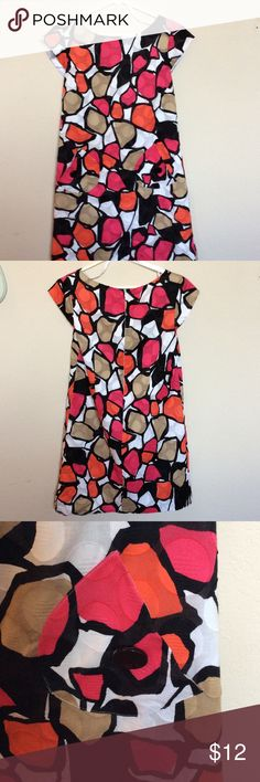 Geometric textured dress Eye popping design with attention to detail. Fully lined unity cute outside pockets sporting black flat buttons.  Cap sleeves. 18 inches from armpit to armpit and 25 inches from pit to hem.  GUC. Kim Rogers Dresses