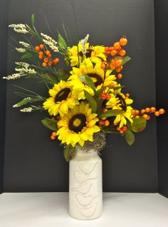 Fall 2014 Season Floral: Fall wild sunflowers, orange berries and blooming wild grass blades on white ceramic bird vase nesting on Spanish Moss. Original design and arrangement by http://nfmdesign.synthasite.com/