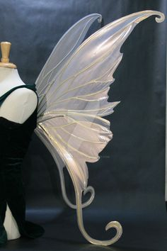 Amazing work! Titania Grand Wings, side by FaeryAzarelle on DeviantArt Aluminum frame wings with gold pearl membrane. © Fancy Fairy and Angela Jarman. www.fancyfairy.com