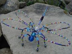 Beaded dragonflies are such delicate, almost spiritual creatures--site has instructions for several types of unique bugs, spiders, etc.more whimsey for the garden Wire Crafts, Bead Crafts, Jewelry Crafts, Arts And Crafts, Wire Jewelry, Beaded Jewelry, Jewelery, Beaded Dragonfly, Blue Dragonfly