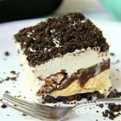 Buster Bar Lasagna – Decadent layers of Oreo cookies, ice cream, hot fudge, Snickers bars!