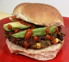 These Spicy Black Bean Veggie Burgers are the BEST veggie burger I've ever had! Topped with avocado and sriracha, each burger is only 400 calories or 9 Weight Watchers SmartPoints! www.emilybites.com
