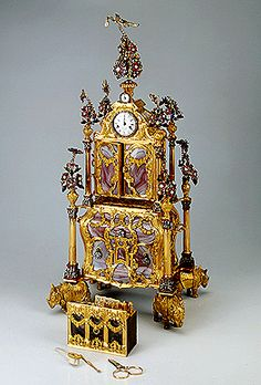 Table clock with a necessaire and a musical mechanism 1772 Made by James Coxe England Gold, silver, agate, pearls, coloured glass and metal alloys; chased and engraved