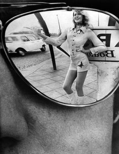 Paris 1971 In Salvadors sunglasses, Helmut Newton for French Vogue | LOVE this shot | reflection | shades | sunglasses | 1970's | vintage black & white photography | hitch a ride | great composition | hot pants | || Desert Lily Vintage