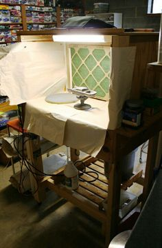 Want to keep your spray booth clean of excess paint, cover it with paper, dispose of it after several uses.