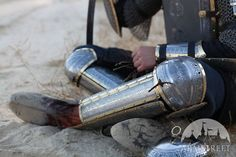 Eastern style functional medieval greaves with cops