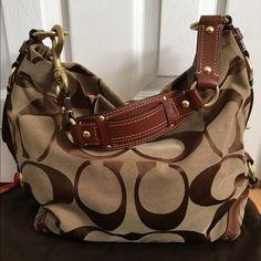 """Coach Signature Large Carly Tan signature Coach Large Carly bag with Saddle leather trim. Dimensions are 15""""x10""""x5"""". Bag was only used a few times, in mint condition, looks brand new, still with original dust bag. Small light stain on bottom shown in photo. No wear otherwise on bottom leather or corners of fabric. Coach Bags Hobos"""