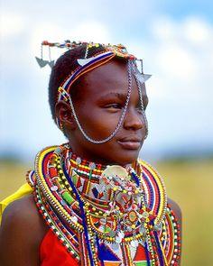 Africa | Maasai girl, Maasai Mara National Park, Kenya.  Image credit Jim Zuckerman