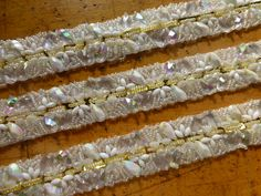 """Trim with various beads, measures at 1.5"""" wide ($85.00 per yard) 4 yards available at this time."""