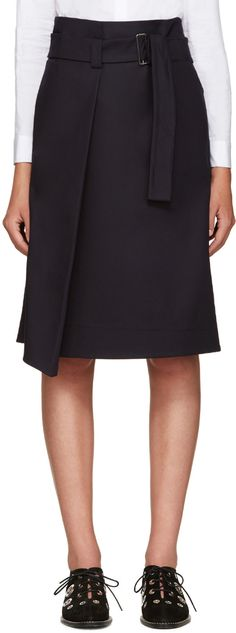 Mid-length cotton skirt in navy. Adjustable cinch belt featuring tonal grosgrain trim at waist. Central pleat at front. Two-pocket styling. Concealed zip closure at side. Tonal stitching.