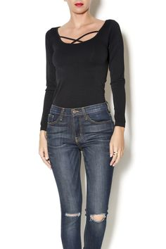 A twist on a classic tee, this black long sleeve stretchy knit has a cool cross strap detail.
