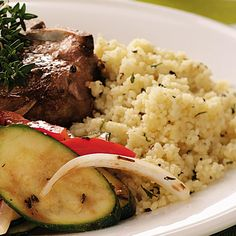 """Seasoned Couscous Recipe -""""Partner it with delicious <B>Seasoned Couscous</B>, and you have a winner,"""" Ruth says. Flecked with basil and parsley, the speedy stovetop side dish comes together in a snap."""
